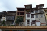 Colonial Houses Perched Above the River