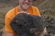 Sean holding a very heavy rock