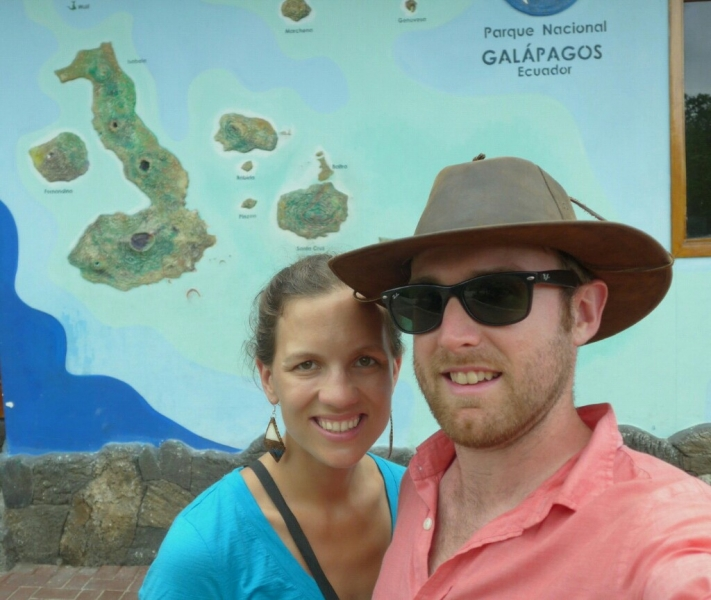 Us with a map of the Galapagos